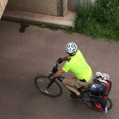 Cyclists biking under Eastern Continental Divide Tunnel
