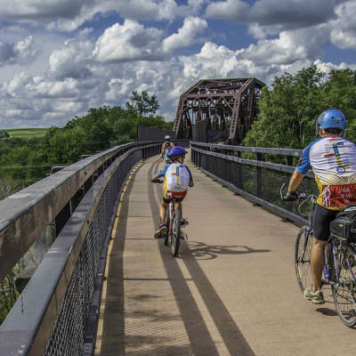 Cyclists biking over Keystone Viaduct