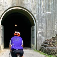 Cyclists entering Big Savage Tunnel