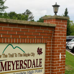 Parking lot with sign in Meyersdale